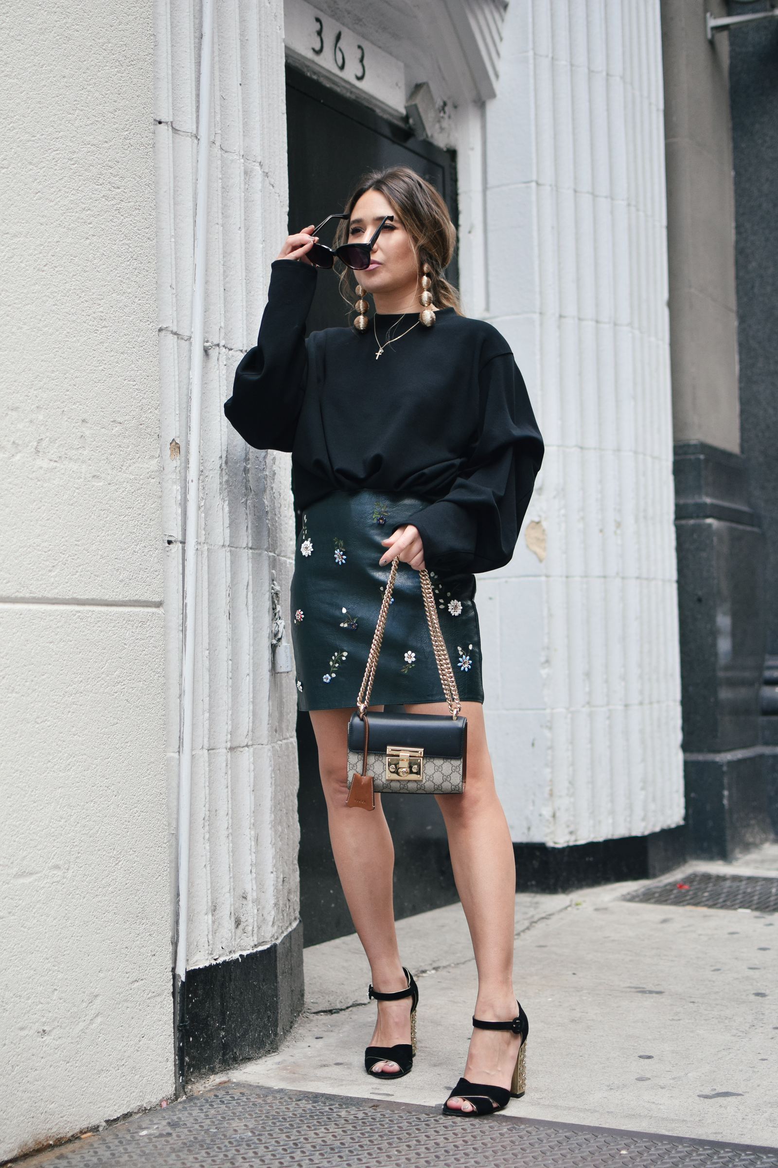 black-sweater-statment-leather-mini-skirt-dolce-and-gabanna-studded-block-heels-oversized-bubble-earring