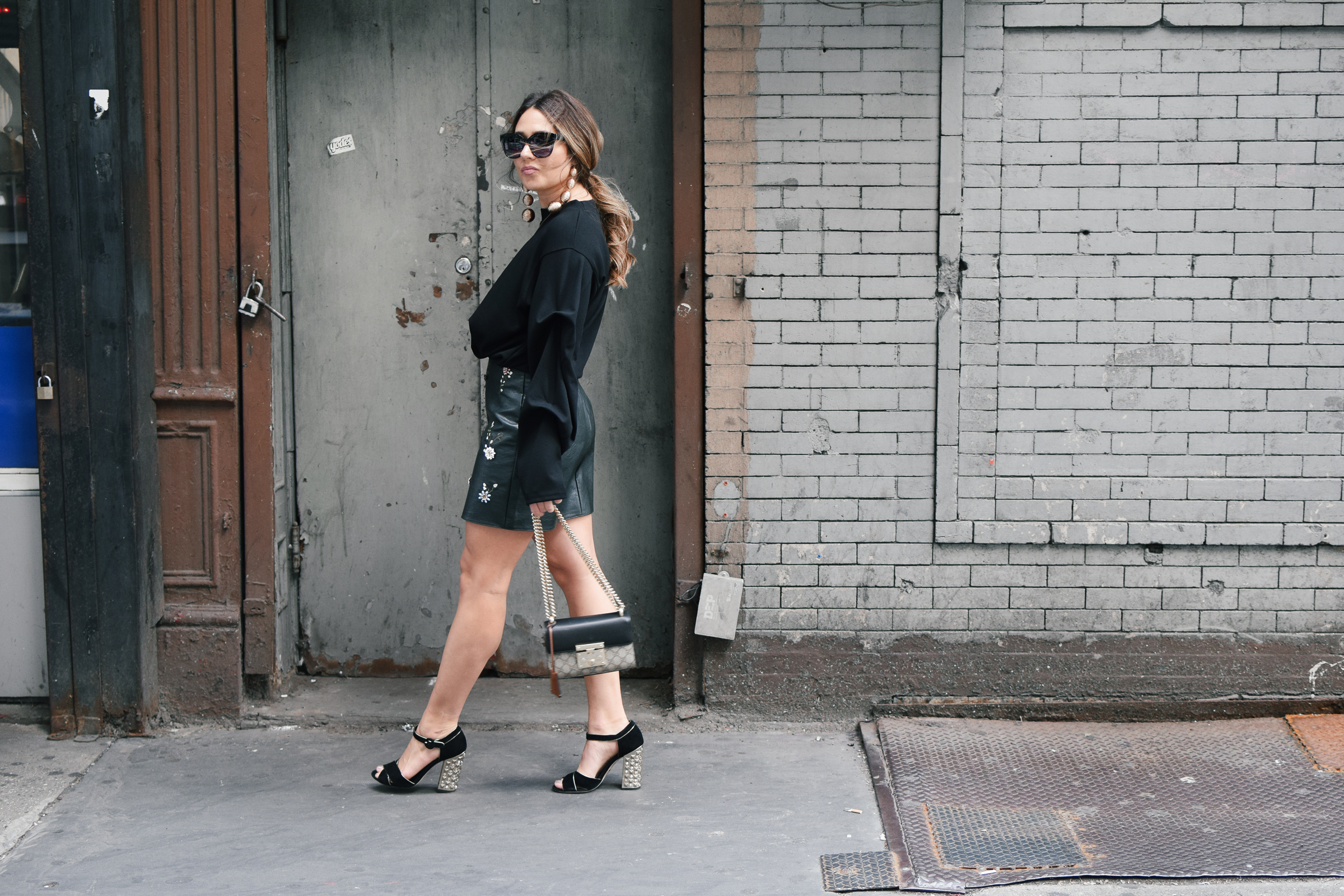black-sweater-statment-leather-mini-skirt-dolce-and-gabanna-studded-block-heels-oversized-bubble-earring-nyfw-streetstyle