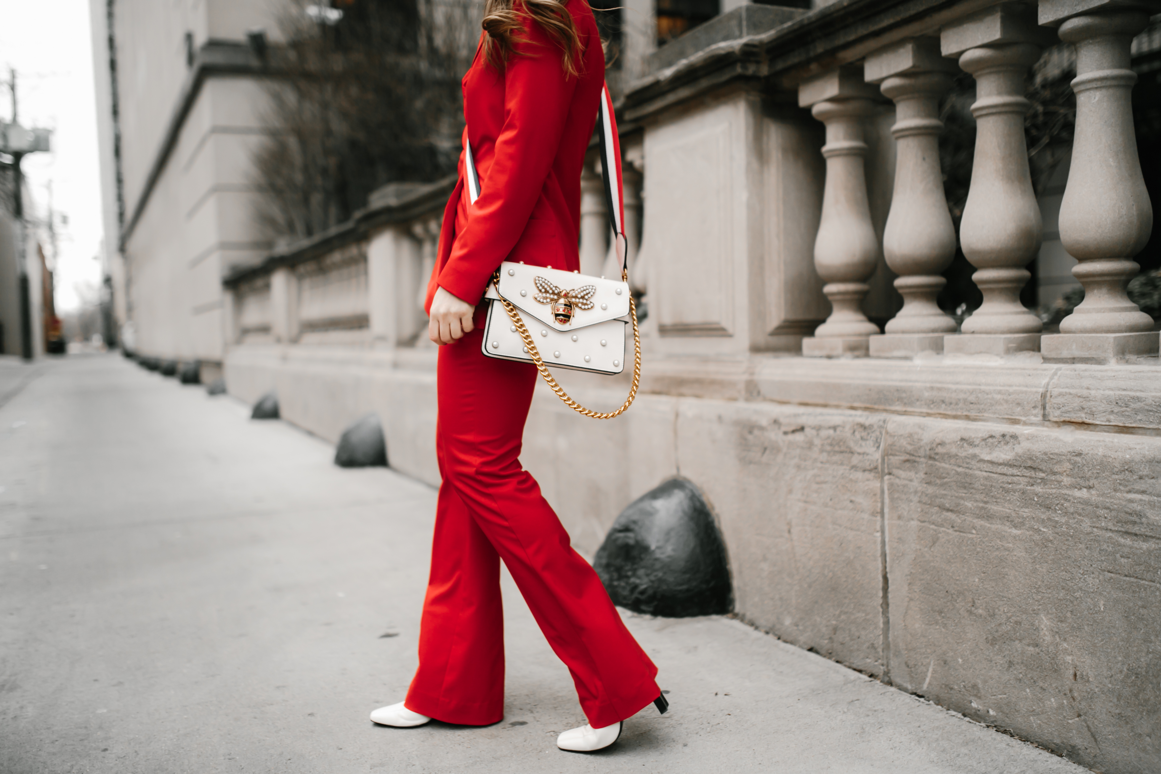 red-suit-gigi-hadid-outfit-inspo-white-gucci-bumble-bee-purse