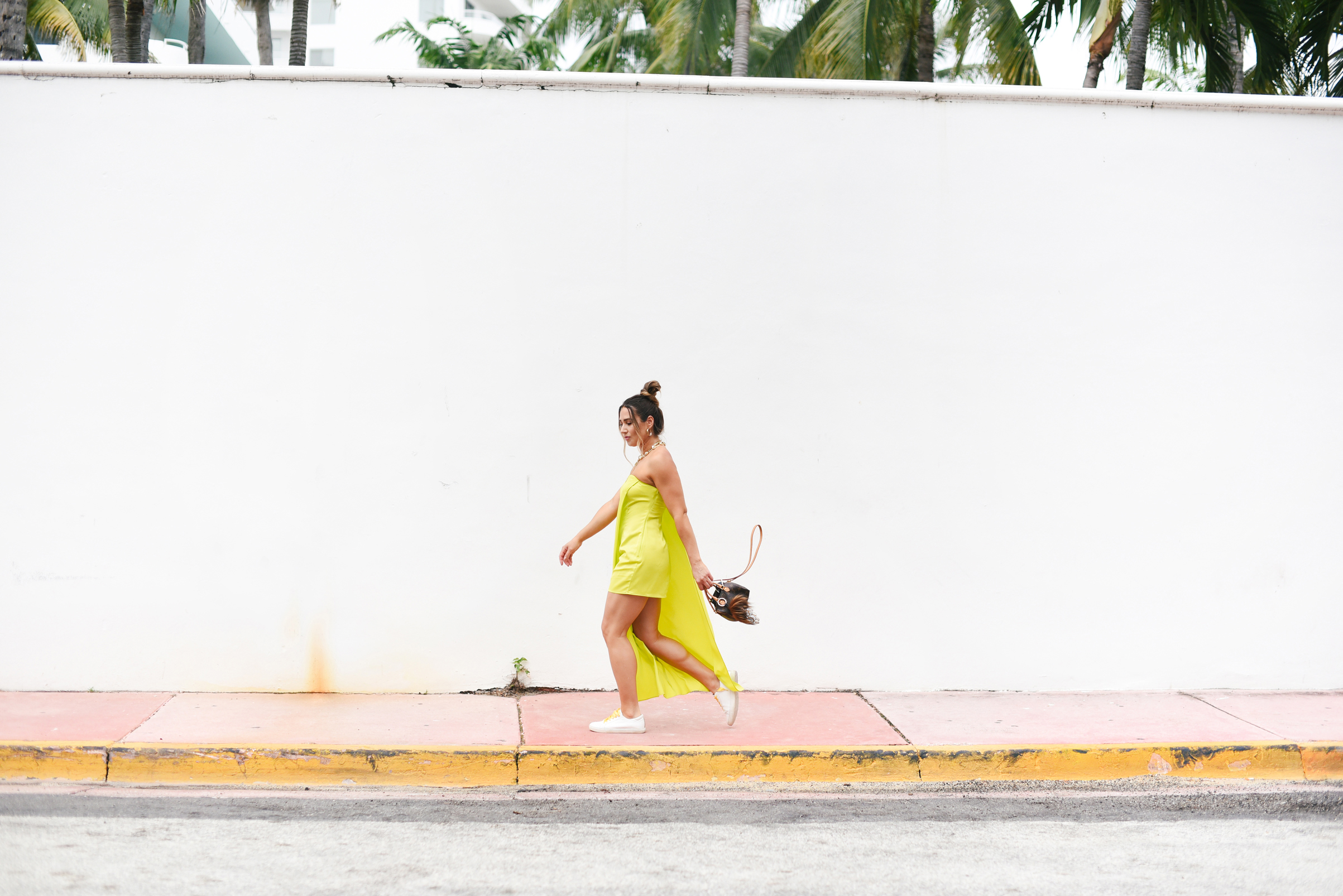 neon-green-dress-trend-sneakers-bright-laces-miami-swim-week-street-style-look